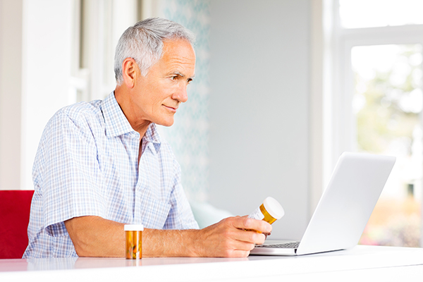 iS-470110737_man_senior_prescriptions_laptop
