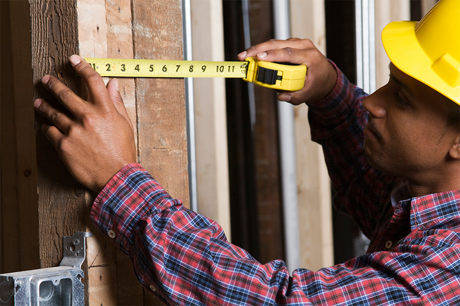iS-182145391-construction worker male measuring_900x600